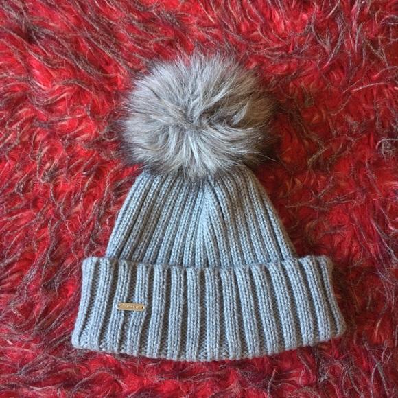 aba93220692 Calvin Klein Accessories - Calvin Klein Faux Fur Pom Beanie